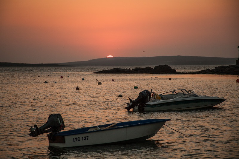 Boats on Langebaan lagoon at sunset